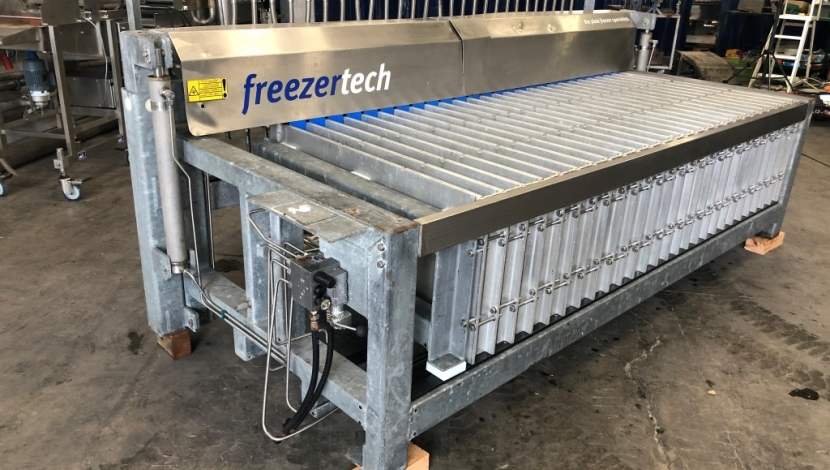 Vertical plate freezers
